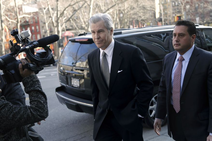 Terry Lundgren (center), Macy's chairman, president and CEO, arrives at New York State Supreme Court in New York on Monday, Feb. 25, 2013, to testify in a trial that pits the department store chain against rival J.C. Penney Co. over a partnership with home diva Martha Stewart. (AP Photo/Seth Wenig)