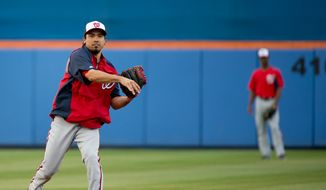 Washington Nationals infielder Anthony Rendon (6) warms up before the Washington Nationals play the New York Mets in spring training baseball at Tradition Field, Port St. Lucie, Fla., Monday, February 25, 2013. (Andrew Harnik/The Washington Times)