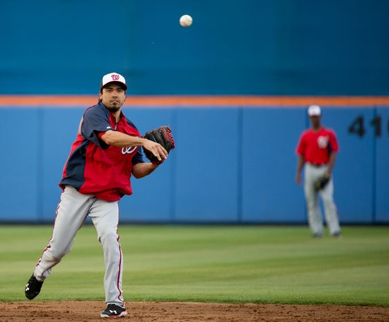 Washington Nationals infielder Anthony Rendon (6) warms up before the Washington Nationals play the New York Mets in spring training baseball at Tradition Field, Port St. Lucie, Fla., Monday, February 25, 2013. (Andrew Harnik/The