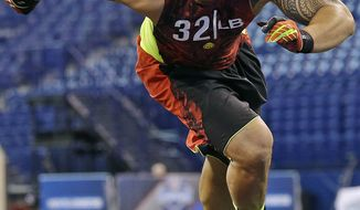 Notre Dame linebacker Manti Te'o runs a drill during the NFL football scouting combine in Indianapolis, Monday, Feb. 25, 2013. (AP Photo/Dave Martin)