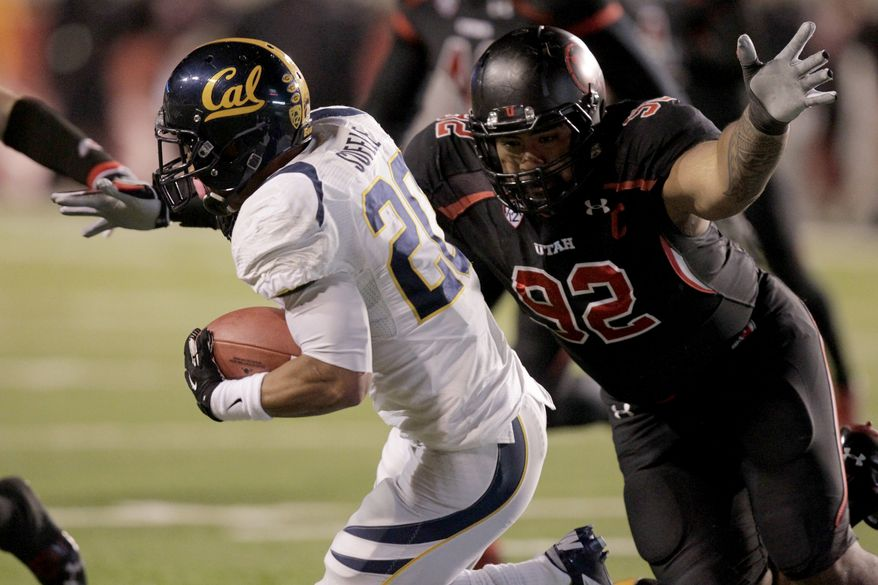 Utah defensive tackle Star Lotulelei (92) dives for California running back Isi Sofele (20) in the first quarter during an NCAA college football game Saturday, Oct. 27, 2012, in Salt Lake City. (AP Photo/Rick Bowmer)