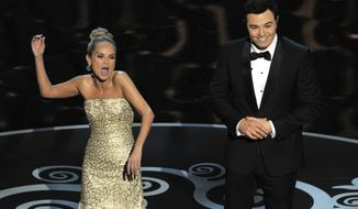 "Host Seth MacFarlane, right, and actress Kristin Chenoweth perform a song dedicated to the ""losers"" during the finale of the Oscars at the Dolby Theatre on Sunday Feb. 24, 2013, in Los Angeles. (Photo by Chris Pizzello/Invision/AP)"