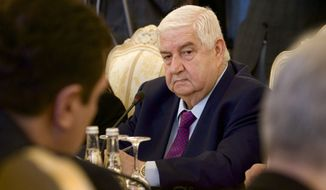 Syrian Foreign Minister Walid al-Moallem attends a meeting with his Russian counterpart Sergey Lavrov, unseen, in Moscow on Monday, Feb. 25, 2013. (AP Photo/Ivan Sekretarev)