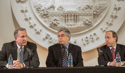 Attorneys General Tim Fox (left) of Montana, Patrick Morrisey (center) of West Virginia and John W. Suthers of Colorado said Tuesday that the Obama administration has undermined their authority by failing to lead on issues that require states to cede to federal supremacy. (Andrew S. Geraci/The Washington Times)