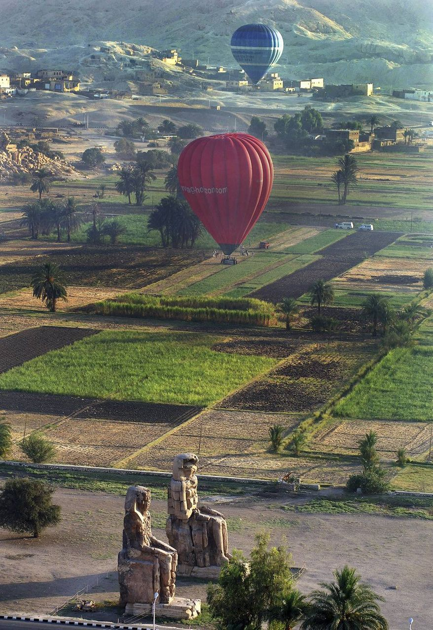 ** FILE ** In this Wednesday, May 24, 2006, file photo, tourists take a hot air balloon tour over Luxor, Egypt. (AP Photo/Mohammed Anan, File)