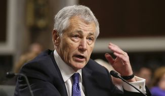 **FILE** Secretary of Defense nominee Chuck Hagel testifies Jan. 31, 2013, before the Senate Armed Services Committee during his confirmation hearing on Capitol Hill in Washington. (Associated Press)