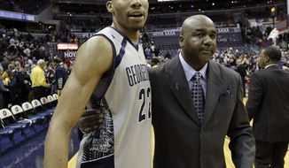 Georgetown forward Otto Porter Jr. (22) celebrates with head coach John Thompson III after an NCAA college basketball game against Marquette, Monday, Feb. 11, 2013, in Washington. Georgetown won 63-55. Porter had game-high 21 points. (AP Photo/Alex Brandon)