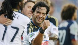**FILE** Philadelphia Union's Carlos Ruiz celebrates his goal in the first half of an MLS soccer game against the New England Revolution in Foxborough, Mass., Sunday, July 17, 2011. The Union won 3-0. (AP Photo/Michael Dwyer)