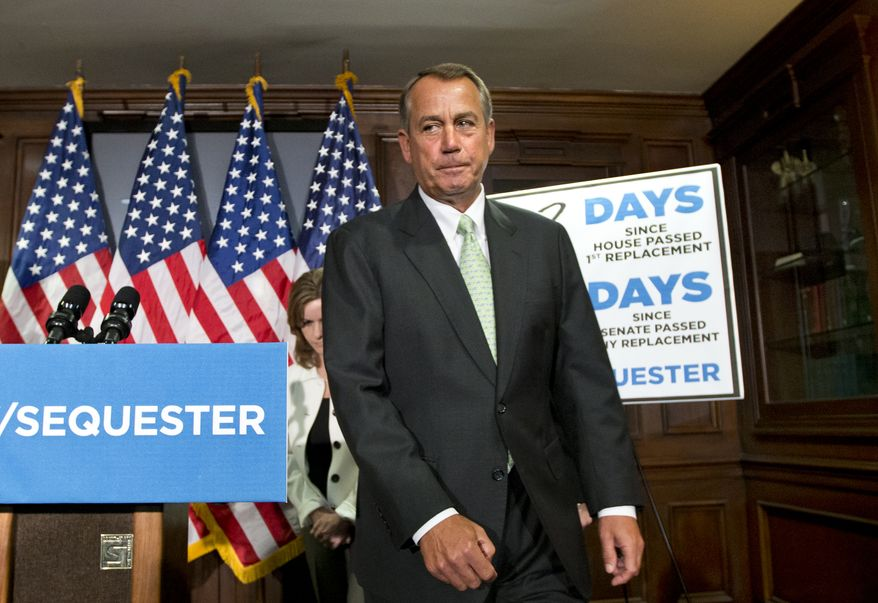 **FILE** House Speaker John Boehner, Ohio Republican, wraps up a news conference Feb. 26, 2013, on Capitol Hill in Washington, where he and GOP leaders challenged President Obama and the Senate to avoid the automatic spending cuts set to take effect four days later. (Associated Press)