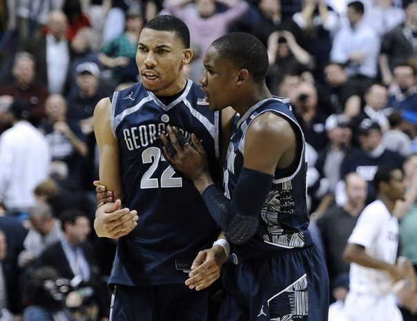 Georgetown's Otto Porter Jr., left, and Georgetown's Aaron Bowen right celebrate their double overtime win in an NCAA college basketball game against Connecticut in Storrs, Conn., Wednesday, Feb. 27, 2013. Georgetown won 79-78. (AP Photo/Jessica Hill)