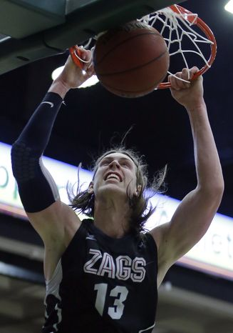 Gonzaga's Kelly Olynyk scores against San Francisco during the second half of an NCAA college basketball game, Saturday, Feb. 16, 2013, in San Francisco. (AP Photo/Ben Margot)