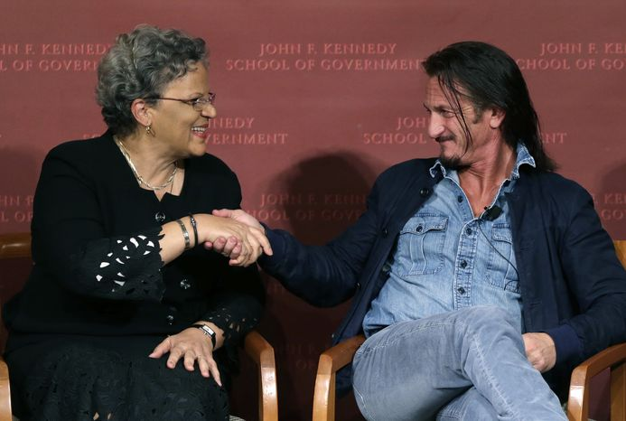 Actor-director Sean Penn (right) shakes hands with Michele Pierre-Louis, the former Haitian prime minister, after they participated in a discussion at Harvard University's Kennedy School of Government in Cambridge, Mass., on Tuesday, Feb. 26, 2013, regarding Haiti in the wake of a devastating earthquake three years ago. Mr. Penn is the co-founder of the J/P Haitian Relief Organization. (AP Photo/Elise Amendola)