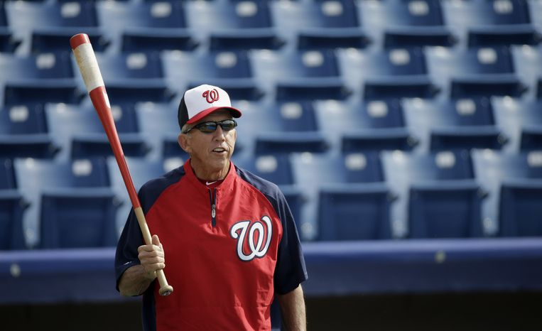 Washington Nationals manager Davey Johnson takes a break from hitting ground balls to first baseman Adam LaRoche before an exhibition spring training baseball game against the Miami Marlins Wednesday, Feb. 27, 2013, in Viera, Fla. (AP Photo/David J. Phillip)