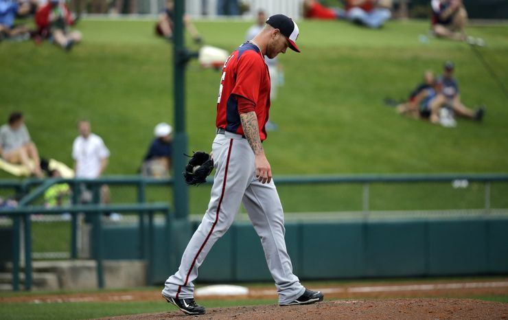 Washington Nationals pitcher Ryan Perry walks back to the mound after giving up a home run to Atlanta Braves' Jordan Parraz during the fifth inning of an exhibition spring training baseball game Tuesday, Feb. 26, 2013, in Kissimmee, Fla. (AP Photo/David J. Phillip)