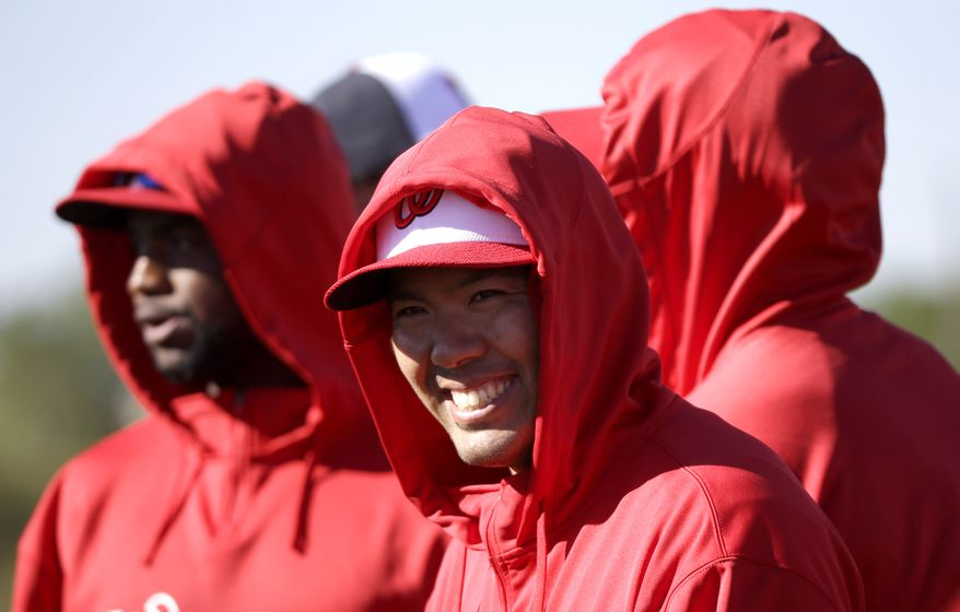 Washington Nationals cactcher Kurt Suzuki smiles during a spring training baseball workout on Sunday, Feb. 17, 2013, in Viera, Fla. (AP Photo/David J. Phillip)