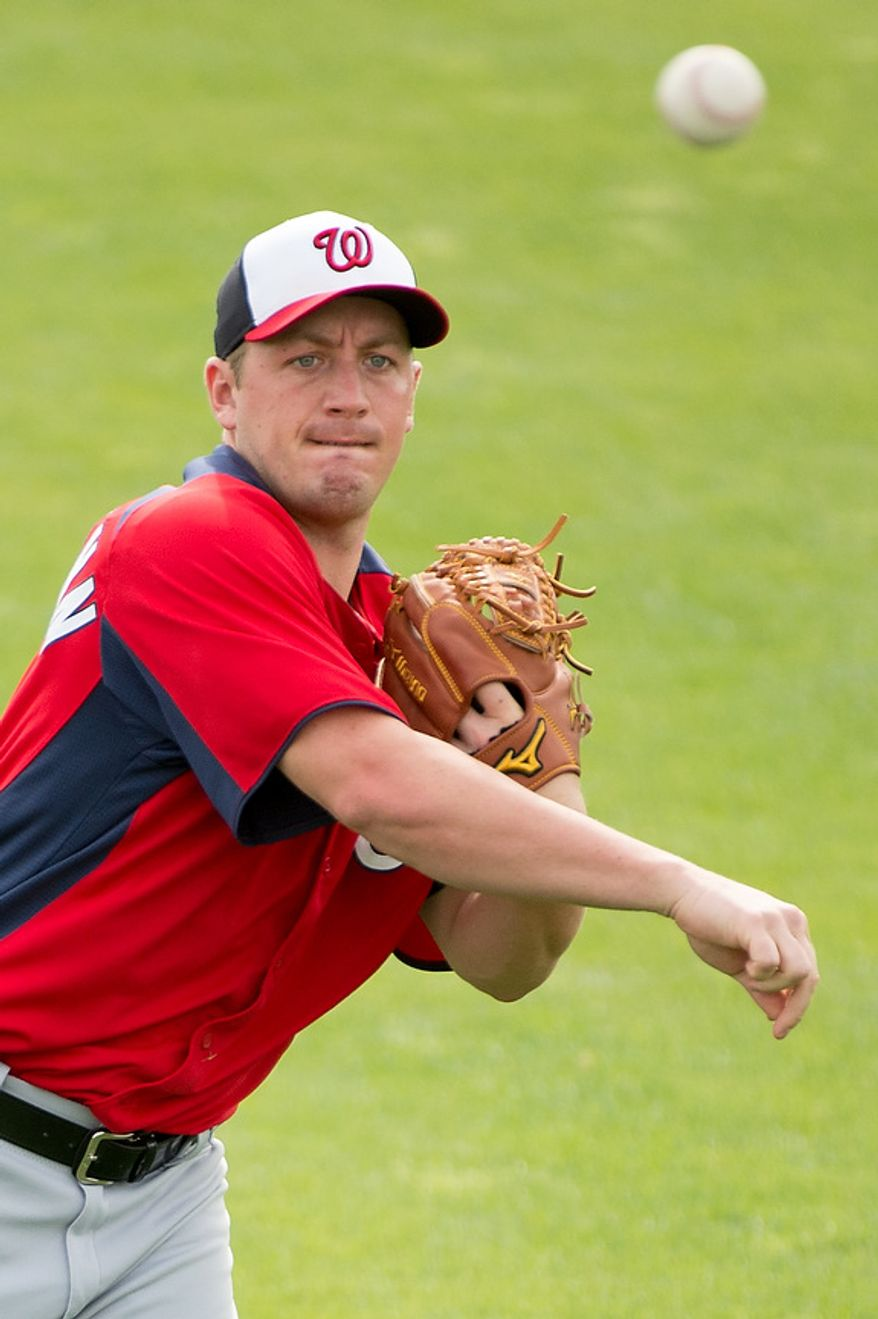 Washington Nationals starting pitcher Jordan Zimmermann (27) warms up at a morning practice during spring training at Space Coast Stadium, Viera, Fla., Tuesday, February 26, 2013. (Andrew Harnik/The Washington Times)