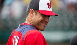 Washington Nationals catcher Sandy Leon (41) smiles as the Washington Nationals play the Atlanta Braves during spring training at Champion Stadium, Kissimmee, Fla., Tuesday, February 26, 2013. (Andrew Harnik/The Washington Times)