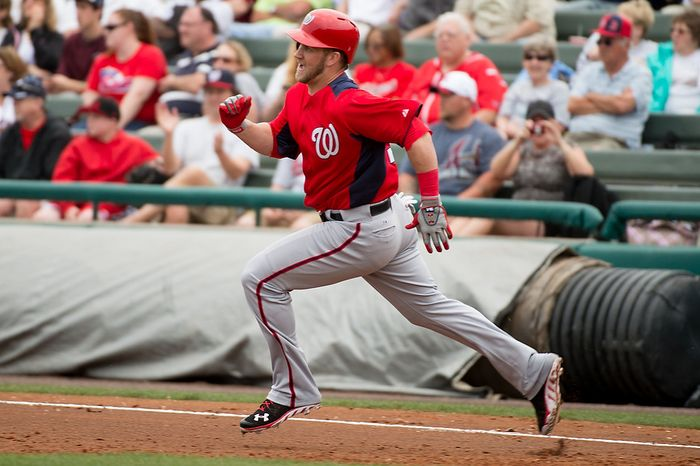 Washington Nationals center fielder Bryce Harper (34) runs to first as the Washington Nationals play the Atlanta Braves during spring training at Champion Stadium, Kissimmee, Fla., Tuesday, February 26, 2013. (Andrew Harnik/The Washington Times)