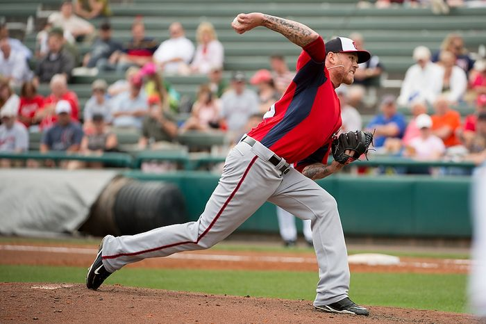 Washington Nationals relief pitcher Ryan Perry (45) pitches as the Washington Nationals play the Atlanta Braves during spring training at Champion Stadium, Kissimmee, Fla., Tuesday, February 26, 2013. (Andrew Harnik/The Washington Times)