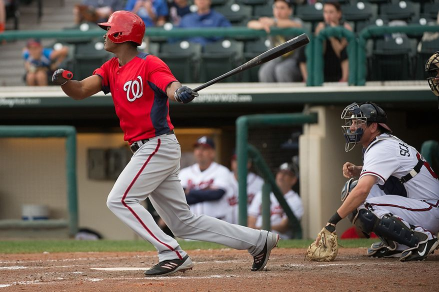 Washington Nationals Taylor (3) hits as the Washington Nationals play the Atlanta Braves during spring training at Champion Stadium, Kissimmee, Fla., Tuesday, February 26, 2013. (Andrew Harnik/The Washington Times)