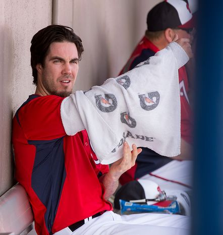 Washington Nationals starting pitcher Dan Haren (15) wraps his arm in the dugout as the Washington Nationals play the Florida Marlins during spring training at Space Coast Stadium, Viera, Fla., Wednesday, February 27, 2013. (Andrew Harnik/The Washington Times)