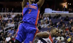 Detroit Pistons guard Brandon Knight shoots over Washington Wizards forward Martell Webster in the first half of an NBA basketball game on Wednesday, Feb. 27, 2013, in Washington. (AP Photo/Alex Brandon)