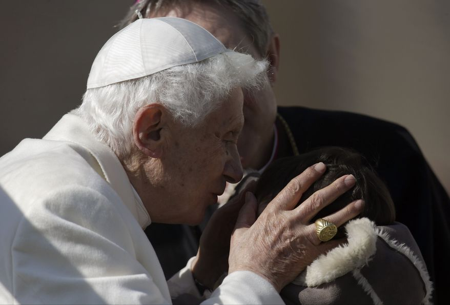 """Pope Benedict XVI kisses a baby during his general audience in St. Peter's Square at the Vatican, Wednesday, Feb. 27, 2013. Pope Benedict XVI basked in an emotional sendoff Wednesday at his final general audience in St. Peter's Square, recalling moments of """"joy and light"""" during his papacy but also times of great difficulty. (AP Photo/Gregorio Borgia)"""