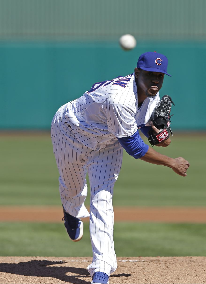 Chicago Cubs starting pitcher Edwin Jackson throws before the first inning of an exhibition spring training baseball game against the Colorado Rockies Tuesday, Feb. 26, 2013, in Phoenix. (AP Photo/Morry Gash)