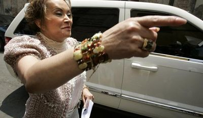 ** FILE ** In this Friday July 14, 2006, file photo, teachers' union head Elba Esther Gordillo gestures as she arrives to attend a meeting with education workers a day after being expelled from Mexico's Institutional Revolutionary Party in Mexico City. (AP Photo/Dario Lopez-Mills, file)
