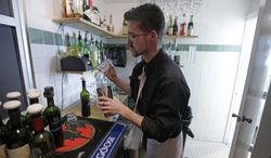 Dustin Humes, manager of the Vivace restaurant in Salt Lake City, fixes a drink out of the view of patrons on Tuesday, Feb. 26, 2013. (AP Photo/Rick Bowmer)