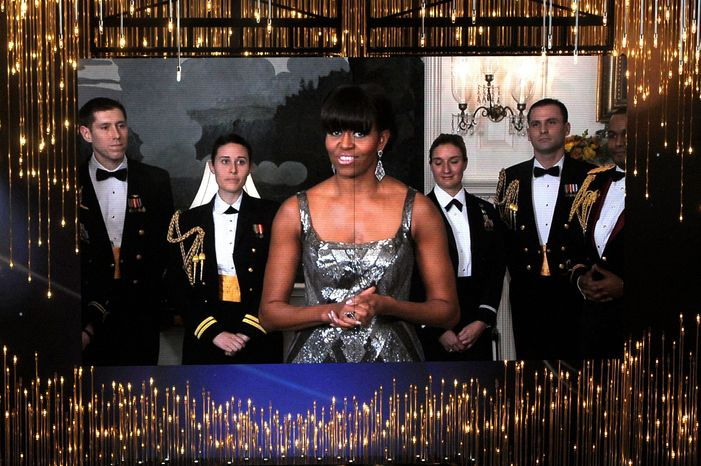 First lady Michelle Obama, on screen from Washington, announcing the best picture