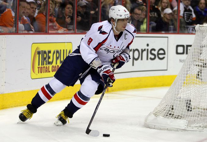 Washington Capitals' Alexander Ovechkin brings the puck from behind the net in the second period of an NHL hockey game against the Philadelphia Flyers, Wednesday, Feb 27, 2013, in Philadelphia. (AP Photo/Tom Mihalek)