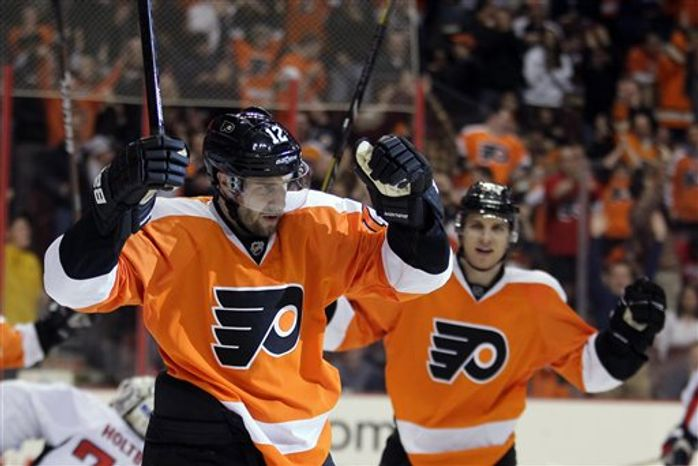 Philadelphia Flyers' Simone Gagne (12) celebrates his goal in the second period of an NHL hockey game againt the Washington Capitals, Wednesday, Feb 27, 2013, in Philadelphia. Gagne returned to the Flyers on Tuesday after playing with the L.A. Kings. (AP Photo/Tom Mihalek)