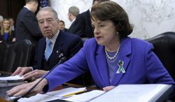 Sen. Dianne Feinstein, D-Calif., right, sits next to the Senate Judiciary Committee's ranking Republican, Sen. Charles Grassley, R-Iowa, during a hearing on the Assault Weapons Ban of 2013, Wednesday, Feb. 27, 2013.. (AP Photo/Susan Walsh)