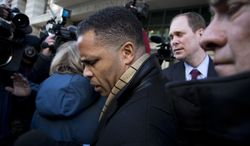 ** FILE ** Former Illinois Rep. Rep. Jesse Jackson Jr. is surrounded as he walks to his car outside the E. Barrett Prettyman Federal Courthouse in Washington, Wednesday, Feb. 20, 2013, after he entered a guilty plea to criminal charges that he engaged in a scheme to spend $750,000 in campaign funds on personal items. (AP Photo/Evan Vucci)