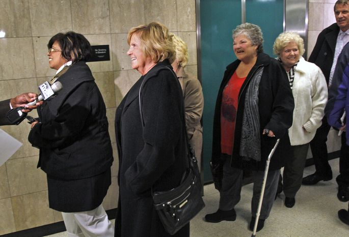 Hairstylists (not identified) from an eastside Indianapolis salon leave a Marion County court on Wednesday, Feb. 27, 2013, in Indianapolis after a hearing on the disputed ownership of a $9.5 m