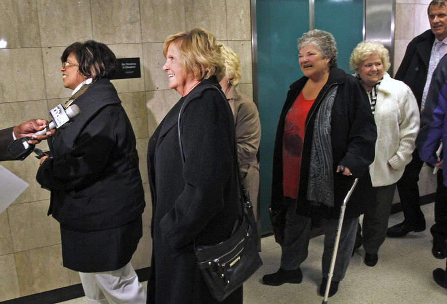 Hairstylists (not identified) from an eastside Indianapolis salon leave a Marion County court on Wednesday, Feb. 27, 2013, in Indianapolis after a hearing on the disputed ownership of a $9.5 million lottery jackpot. (AP Photo/The Indianapolis Star, Kelly Wilkinson)