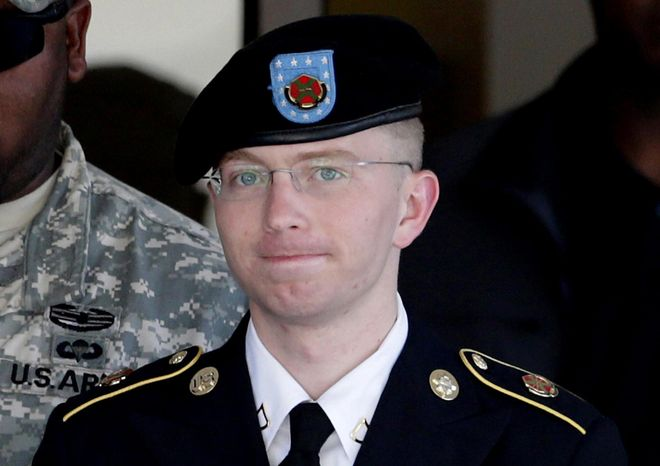 ** FILE ** In this June 25, 2012, file photo, Army Pfc. Bradley Manning, right, is escorted out of a courthouse in Fo