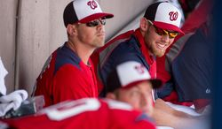 Washington Nationals starting pitcher Stephen Strasburg (37), right, laughs in the dugout as the Washington Nationals play the Florida Marlins during spring training at Space Coast Stadium, Viera, Fla., Wednesday, February 27, 2013. (Andrew Harnik/The Washington Times)