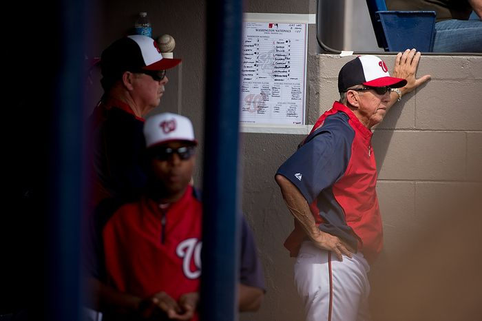 Washington Nationals manager Davey Johnson (5), right, watches game action from the dugout as the Washington Nationals play the Florida Marlins during spring training at Space Coast Stadium, Viera, Fla., Wednesday, February 27, 2013. (Andrew Harnik/Th