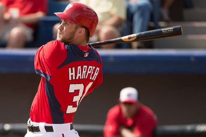 Washington Nationals center fielder Bryce Harper (34) hits as the Washington Nationals play the Florida Marlins during spring training at Space Coast Stadium, Viera, Fla., Wednesday, February 27, 2013. (Andrew Harnik/The