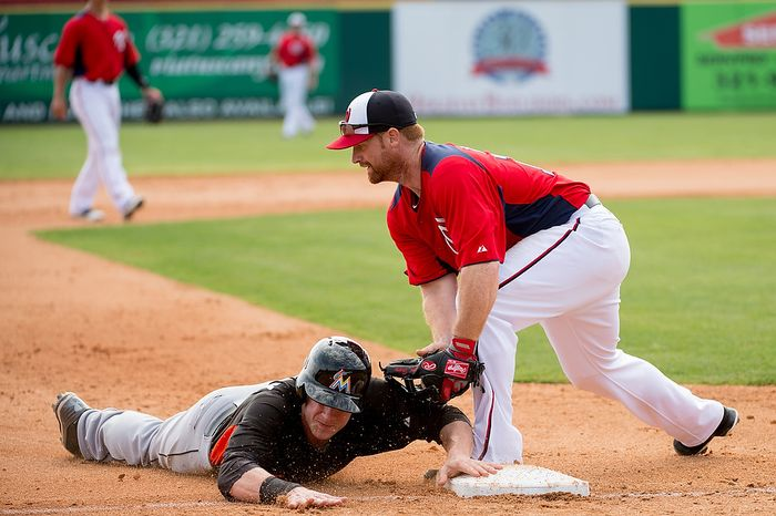 Washington Nationals first baseman Chad Tracy (18) can't get the tag in time as the Washington Nationals play the Florida Marlins during spring training at Space Coast Stadium, Viera, Fla., Wednesday, February 27, 2013. (Andrew Harnik/The Washington Times)