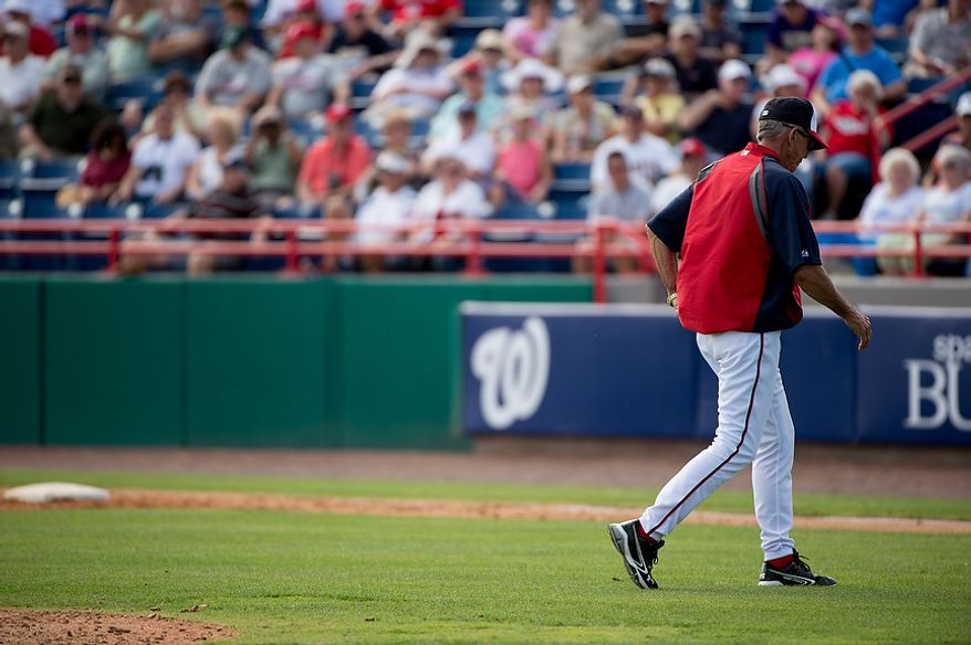 Washington Nationals manager Davey Johnson (5) heads back to the dugout as the Washington Nationals play the Florida Marlins during spring training at Space Coast Stadium, Viera, Fla., Wednesday, February 27, 2013. (Andrew Harnik/The Washington Times)