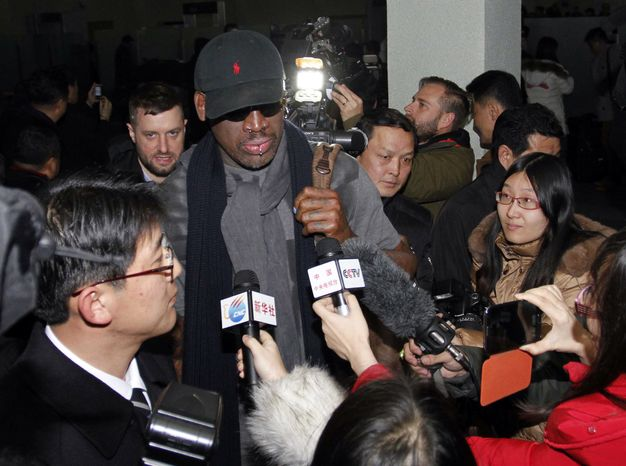 Flamboyant former NBA star Dennis Rodman is surrounded by journalists upon his arrival in Pyongyang, North Korea, on Tuesday, Feb. 26, 2013. (AP Photo/Kim Kwang Hyon)