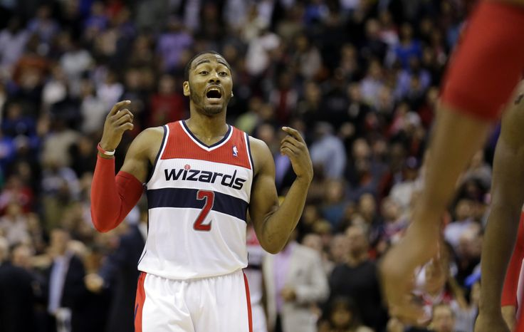 Washington Wizards guard John Wall (2) talks in the second half of an NBA basketball game against the Washington Wizards Saturday, Feb. 23, 2013 in Washington. The Wizards won 105-103. (AP Photo/Alex Brandon)
