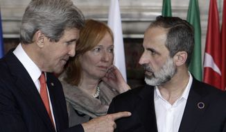 U.S. Secretary of State John Kerry, left, talks to Syrian opposition coalition leader Mouaz al-Khatib, during an international conference on Syria at Villa Madama, Rome, Thursday, Feb. 28, 2013. (AP Photo/Riccardo De Luca)