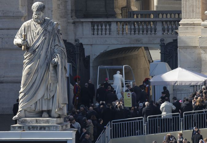 Pope Benedict XVI is seen leaving St. Peter's Square on his pope-mobile after his last general audience, at the Vatican, Wednesday, Feb. 27, 2013. (AP Photo/Dmitry Lovetsky)