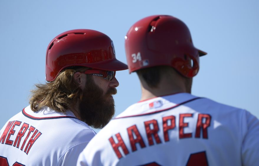 Washington Nationals outfielder Jayson Werth (28) and Bryce Harper, right, wait to take batting practice at spring training baseball in Viera, Fla., Wednesday, Feb. 20, 2013.(AP Photo/Phelan M. Ebenhack)