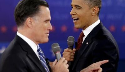 ** FILE ** In this Oct. 16, 2012 photo, President Obama, right, and Republican presidential candidate, former Massachusetts Gov. Mitt Romney exchange views during the second presidential debate at Hofstra University in Hempstead, N.Y. Obama and Romney, bitter campaign foes just weeks ago, are to share a lunch on Thursday, Nov. 29, 2012, at the White House with an eye on overlapping interests rather than the sharp differences that defined their presidential contest. (AP Photo/David Goldman, File)