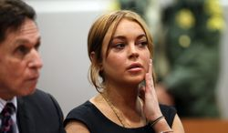 **FILE** Lindsay Lohan sits in a Los Angeles court with her attorney Mark Heller on Jan. 30, 2013, for a pretrial hearing in a case filed over the actress' June car crash. (Associated Press)